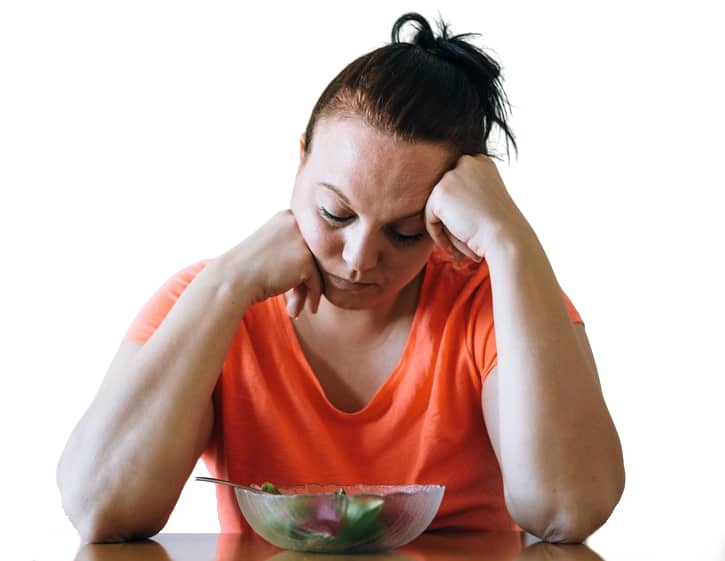 Woman bored with her food
