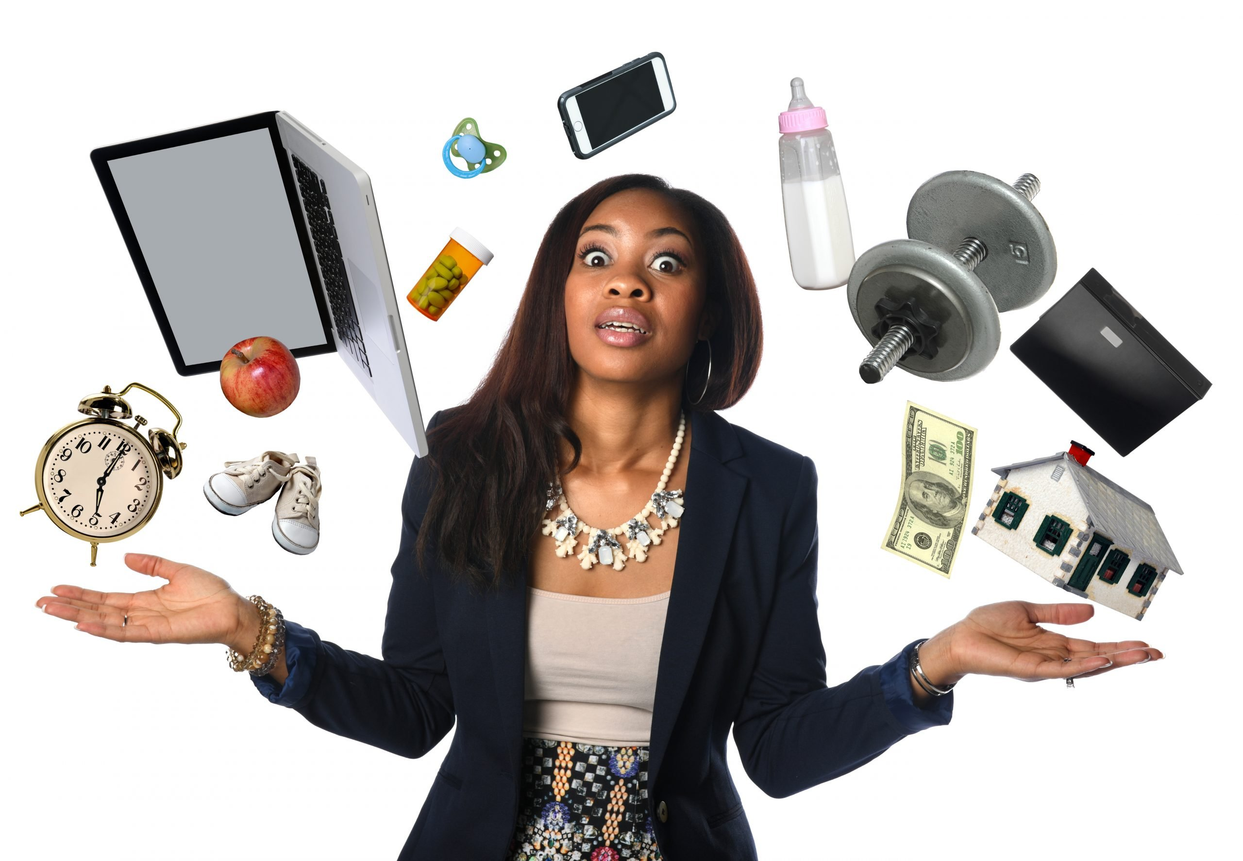 woman juggling too many things in her life