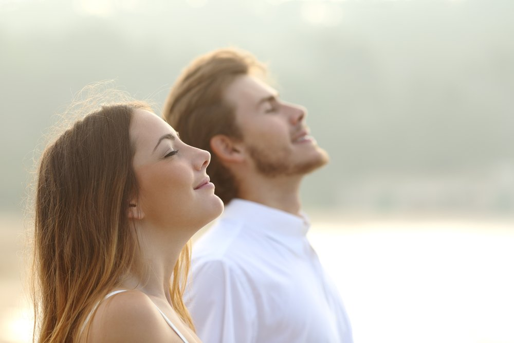 man and woman deep breathing